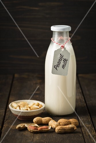 Peanut milk in a glass bottle with a label