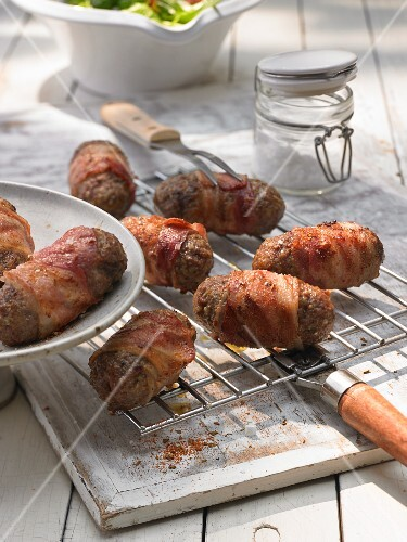 Cevapcici (minced meat sausages wrapped in bacon)