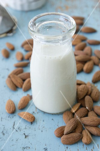 A bottle of almond milk and almonds