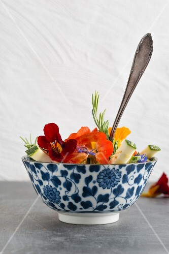 Pepper and courgette salad with nasturtium flowers, rosemary and chilli