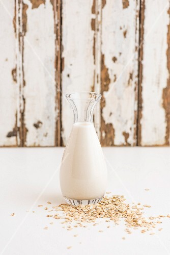 Oats and a bottle of oat milk