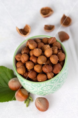 Shelled hazelnuts in a ceramic bowl