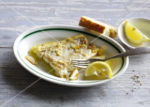 Cod fillet in garlic oil