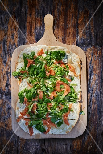 Tarte flambée with smoked salmon and lamb's lettuce