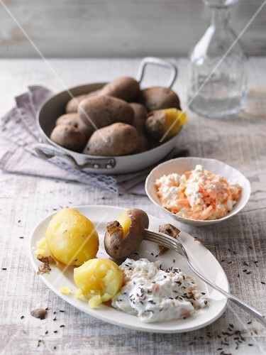 New potatoes with a carrot dip and cheese cream