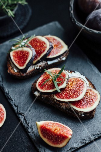 Slices of bread topped with cream cheese and figs