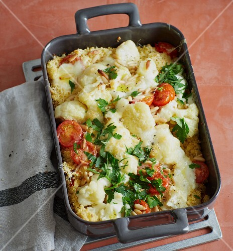 Cauliflower bake with couscous, tomatoes and mozzarella cheese