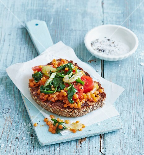 Lentil bruschetta with baby spinach and plum tomatoes