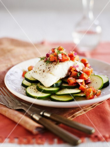 Cod fillet with papaya sauce on courgette slices
