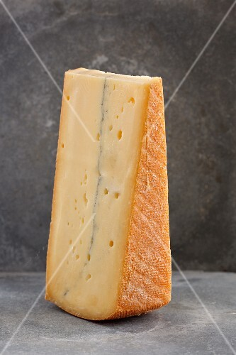 A slice of French Morbier cheese