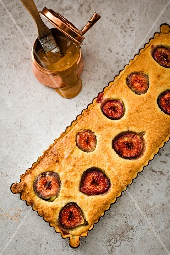 Fig and almond cake with chocolate and caramel sauce