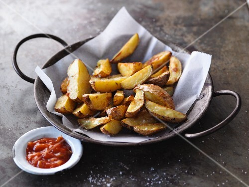 Homemade potato wedges with a Mexican sauce