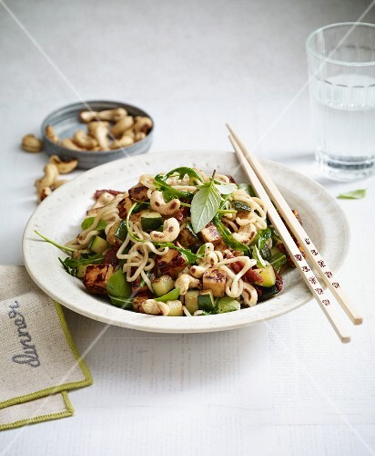 Stir-fried Mediterranean noodles with halloumi, cashew nuts and courgette
