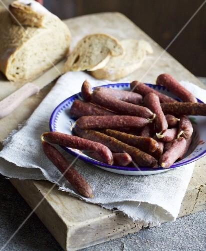 An arrangement of various raw sausages
