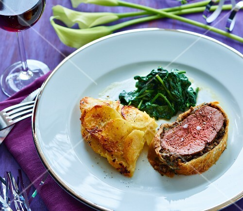 Fillet Wellington with a warm spinach salad and potato gratin
