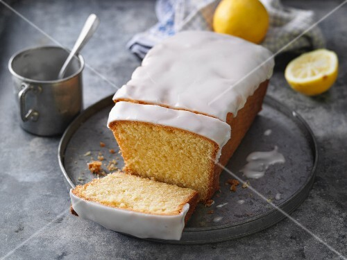 Classic lemon cake with icing, sliced