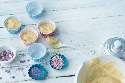 Muffin mix in paper cases and sugar decorations for children