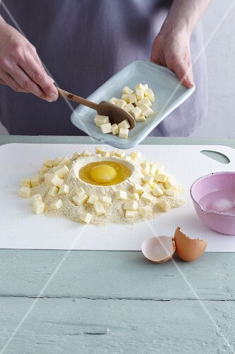 Gluten-free ingredients for making shortcrust pastry piled on a work surface