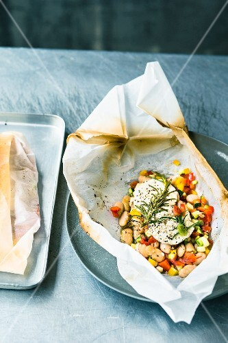 A bean medley with goat's cream cheese on parchment paper