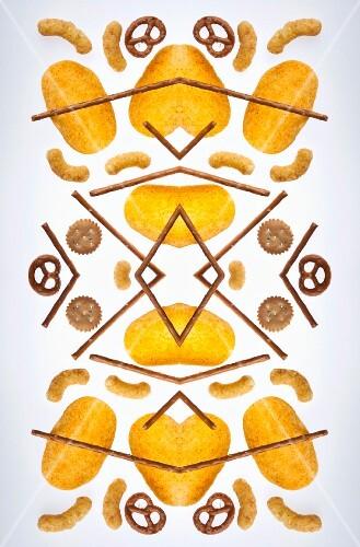 A digital composition of mirrored images of unhealthy snacks