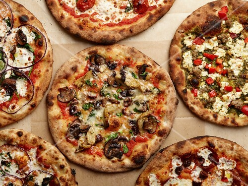 Pizzas with different toppings (seen from above)