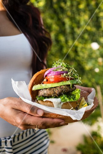 A vegan burger with cashew mayonnaise and beansprouts