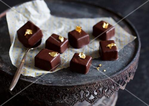 Dark chocolate bite with gold leaf
