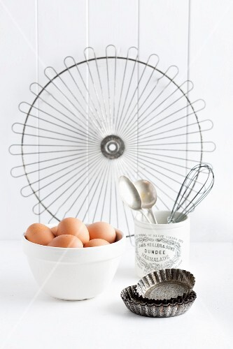 Eggs and various baking utensils