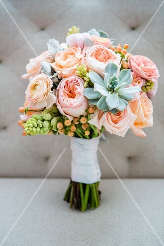 A bridal bouquet with pink flowers and succulents