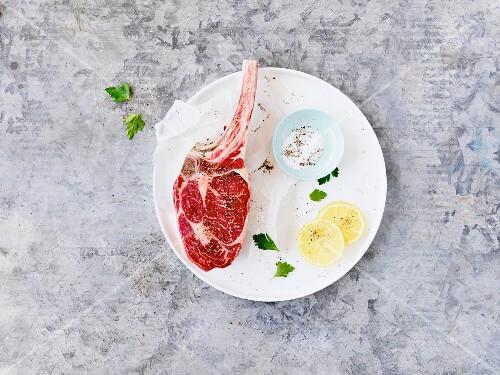 A raw steak on white plate