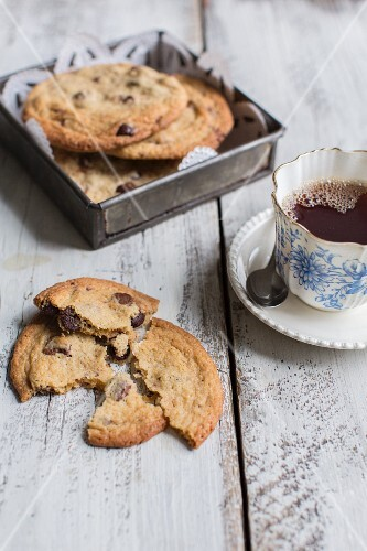 Chocolate chip cookies with a cup of tea