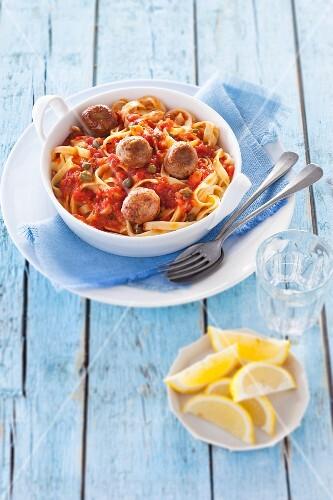 Tagliatelle with tuna balls and tomato & caper sauce
