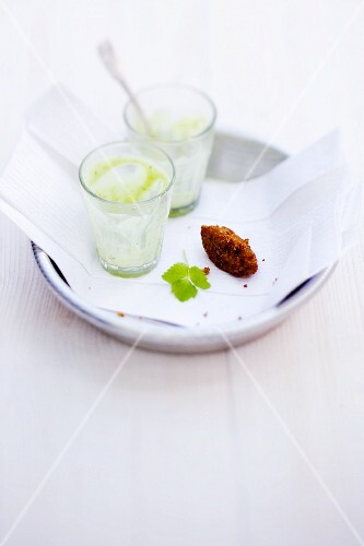 Glasses of avocado and elderflower lassi with coriander and spiced falafel