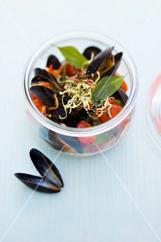 Mussels in a tomato and coconut broth with crispy ginger pesto in a jar