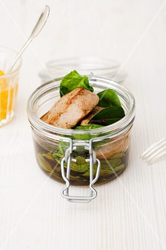 Veal fillet with spinach in a clove and lime leaf broth in a jar