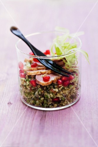 Tea-smoked duck breast with a celery and pomegranate tabbouleh in a glass