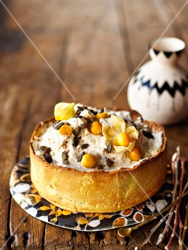 African ice cream cake with pumpkin seeds and physalis