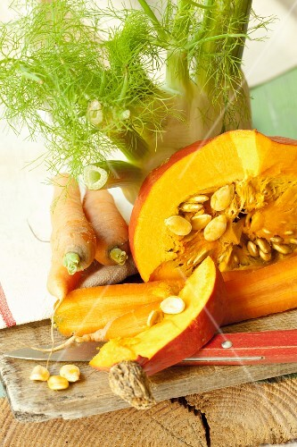 An arrangement of vegetables with pumpkin, carrots and fennel