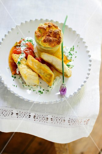 Zander with quark souffle and tomatoes