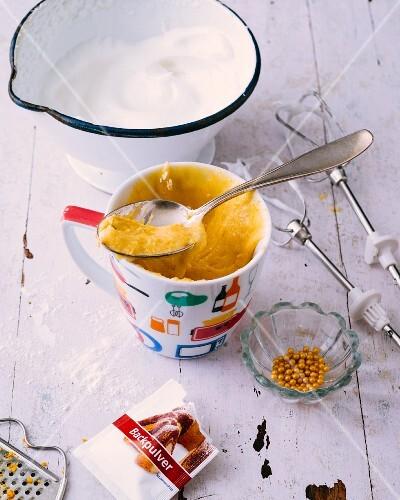 Mug cakes: unbaked cake mixture in a mug