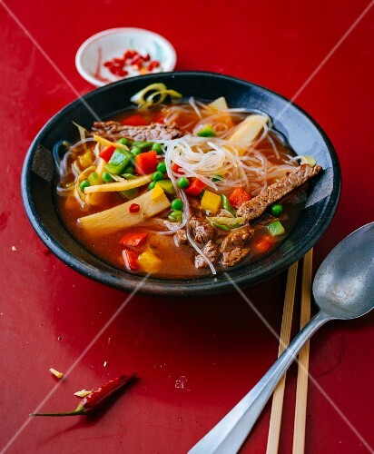 Spicy glass noodle soup with beef, ginger and peppers