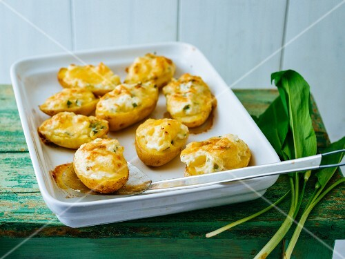 Stuffed spring potatoes with melted cheese
