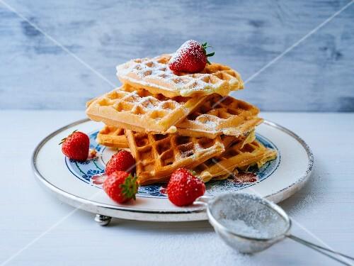 Sponge waffles with fresh strawberries