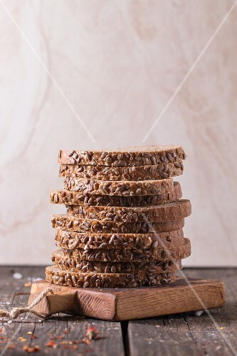 A stack of wholemeal bread on a wooden board