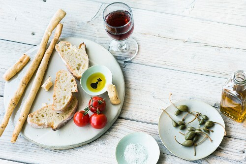 An arrangement of international bread featuring grissini and ciabatta