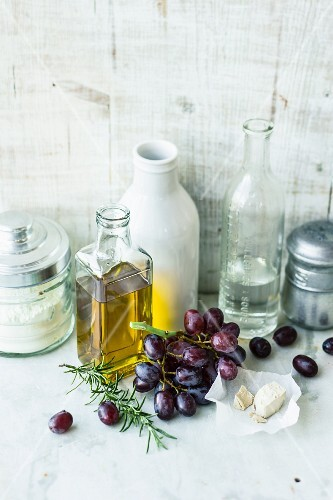 Ingredients for focaccia with grapes, yeast and olive oil