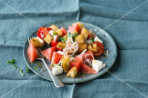 Bread salad with watermelon, cherry tomatoes and feta cheese