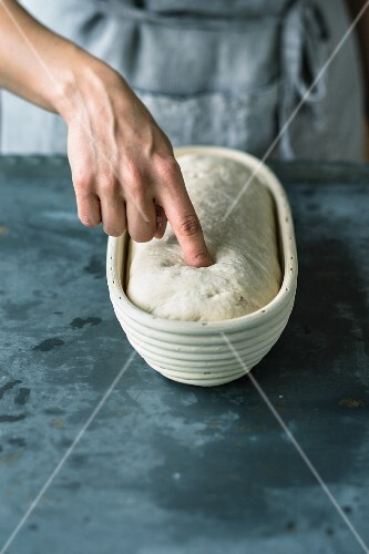 A pressure test for bread dough in a leavening basket