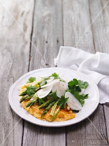 Breakfast omelette with green asparagus and white radish