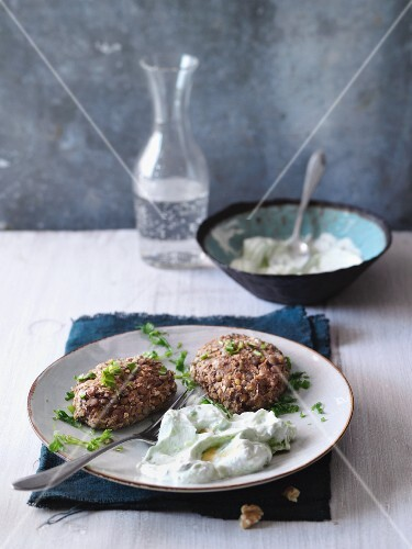 Lentil and walnut cakes with an avocado and yoghurt dip